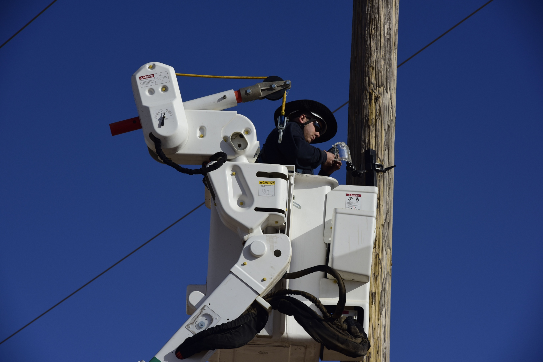 Sunflower's Dalton Pollman, Journey Line Technician, changes out a time-lapse camera on 11-19-19 at the Johnson Corner Solar Project in Stanton County.